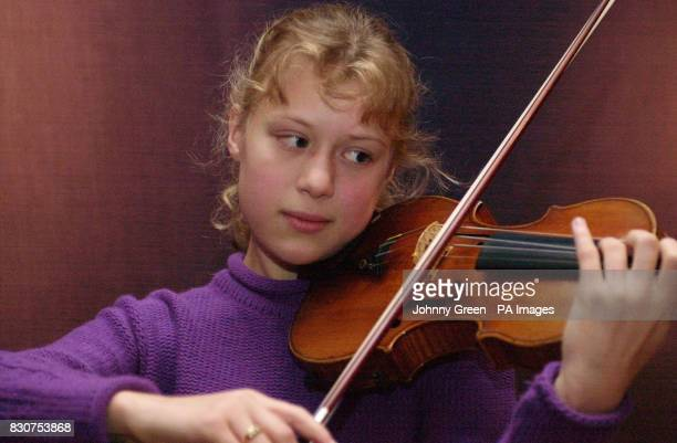German violin prodigy Maria Elizabeth Lott serenades auction goers with a performance on a Stradivarius violin which is expected to fetch up to...