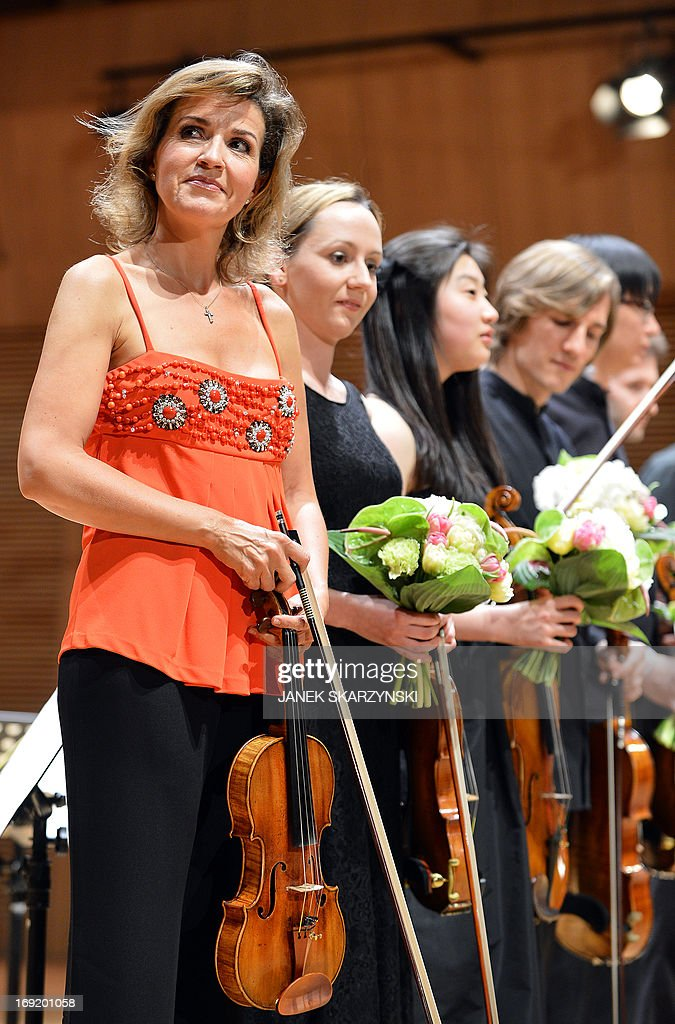 German violinist Anne-Sophie Mutter (L) and members of Mutter's Virtuosi react after their performance during the opening of the Krzysztof Penderecki European Centre for Music in Luslawice, southeastern Poland, on May 21, 2013.