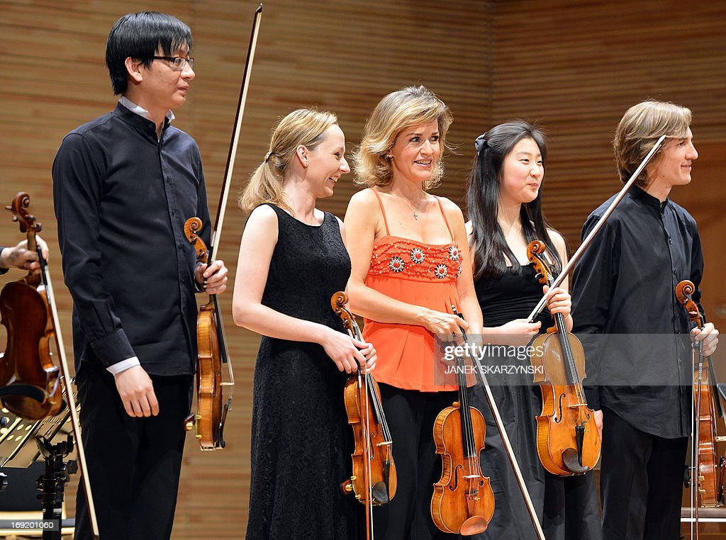 German violinist Anne-Sophie Mutter (C) and members of Mutter's Virtuosi react after their performance during the opening of the Krzysztof Penderecki European Centre for Music in Luslawice, southeastern Poland, on May 21, 2013.