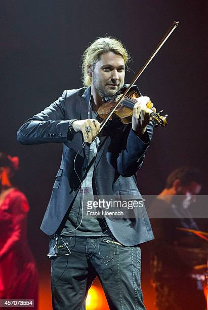 German violinist David Garrett performs live during a concert at the O2 World on October 11 2014 in Berlin Germany
