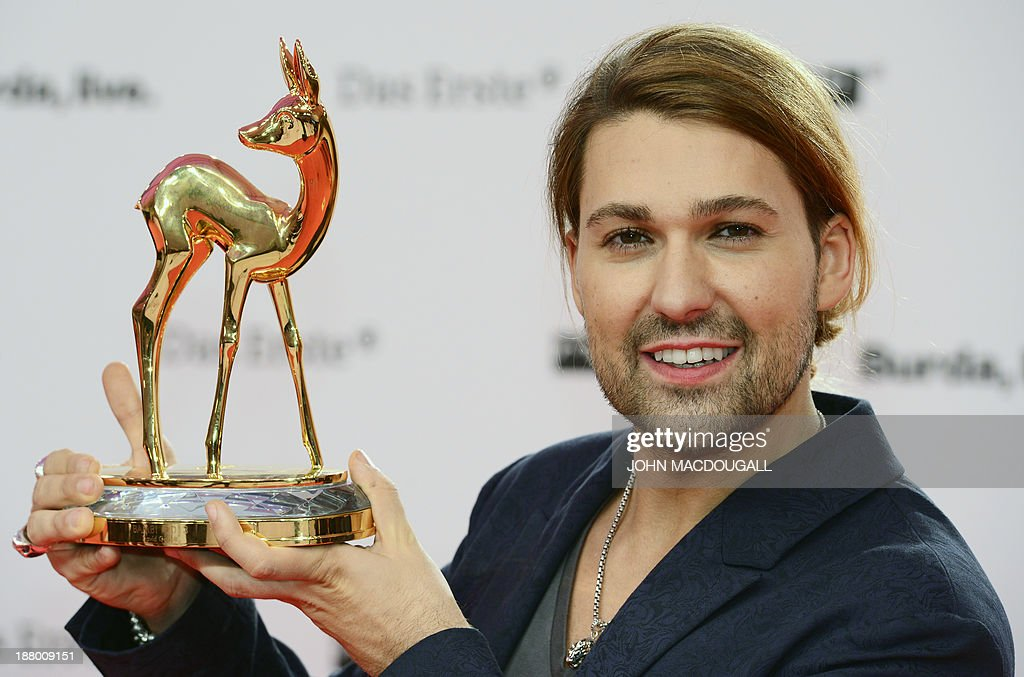 German violinist David Garrett poses for photographers with his Bambi awards at the Stage theatre at Potsdamer Platz in Berlin on November 14, 2103. The awards ceremony ubder the patronage of German publisher Hubert Burda and awards nominees in the sectors of communication, entertainment and show business as well as economy, politics and sports. AFP PHOTO / JOHN MACDOUGALL
