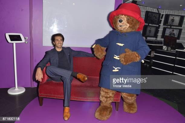 German voice of Paddington Bear Elyas M'Barek poses as wax figure next to Paddington Bear at Madame Tussauds on November 8 2017 in Berlin Germany