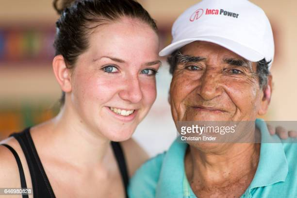 German volunteer at work in a hospital with a patient on February 06 2015 in Piura Peru