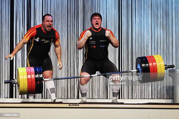 German weightlifters Almir Velagic and Matthias Steiner celebrate after setting a new world record by lifting a total of 330 kilos on a tandem...