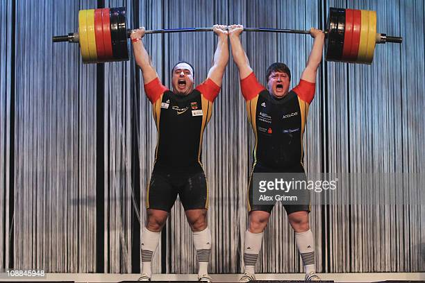 German weightlifters Almir Velagic and Matthias Steiner set a new world record lifting a total of 330 kilos on a tandem barbell during the 20011...