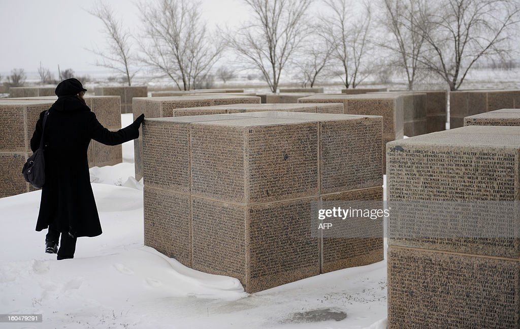 A German woman touches one of the monuments with names of Wehrmacht soldiers who died in the Battle of Stalingrad during the World War II, at a German military cemetery in the Russian village of Rossoshka, some 40 km outside the city of Volgograd, formerly Stalingrad, on February 1, 2013. In a new display of national pride and reminder of its status as a world power, Russia remembers this weekend the Red Army victory in the battle of Stalingrad over invading Nazi forces, one of the bloodiest battles in human history. AFP PHOTO / MIKHAIL MORDASOV
