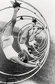 German women race across a lawn in hoopla wheels