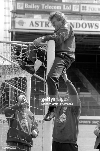 German World Cup goalkeeper Sepp Maier gets in a Tangle at Maine Road to promote a new scratch card game with help from fellow keepers Gordon Banks...