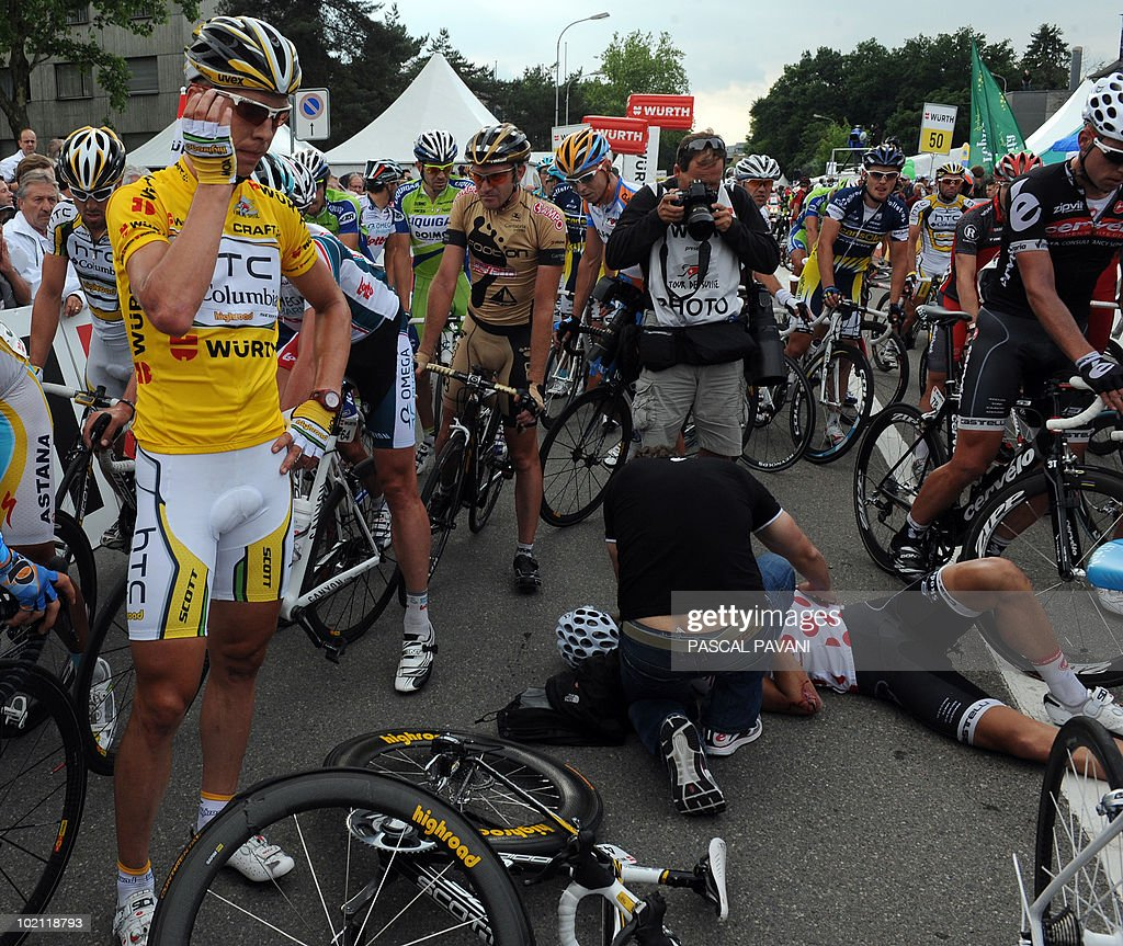 German yellow jersey leader Tony Martin stands by an injured cyclist who crashed near the finish line during the fourth stage Schawarzenburg - Wettingen of the Tour de Suisse (Tour of Switzerland) cycling race on June 15, 2010.