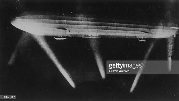 A German zeppelin caught in the searchlights during a bombing raid