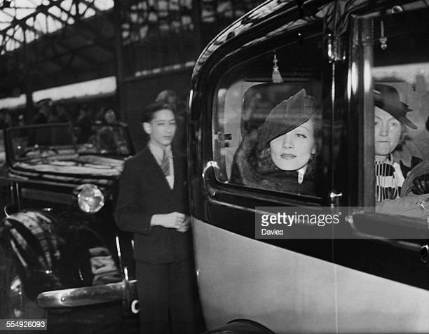 GermanAmerican actress Marlene Dietrich leaving Victoria Station in a car after arriving in London 30th July 1936