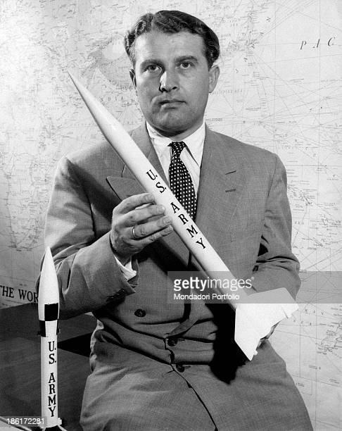 GermanAmerican scientist and engineer Wernher Von Braun born Wernher Magnus Maximilian Freiherr Von Braun poses with smallscale models of rocket he...