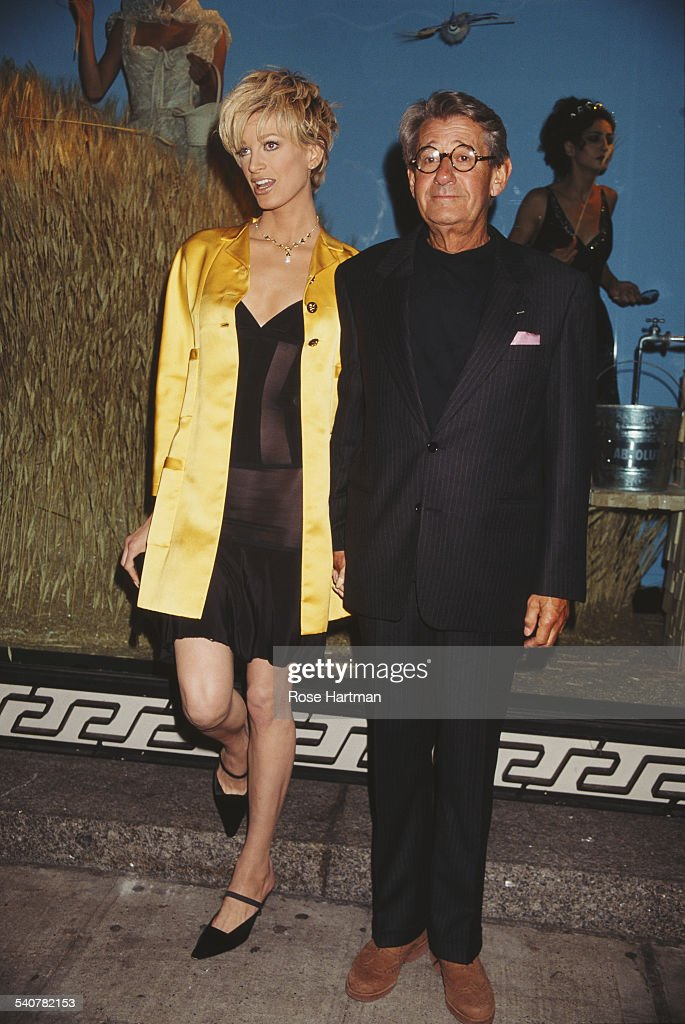 German-Australian photographer Helmut Newton (1920 - 2004) and American model Kristen McMenamy at a party being held in Newton's honour in Barneys department store, New York City, USA, 1995.