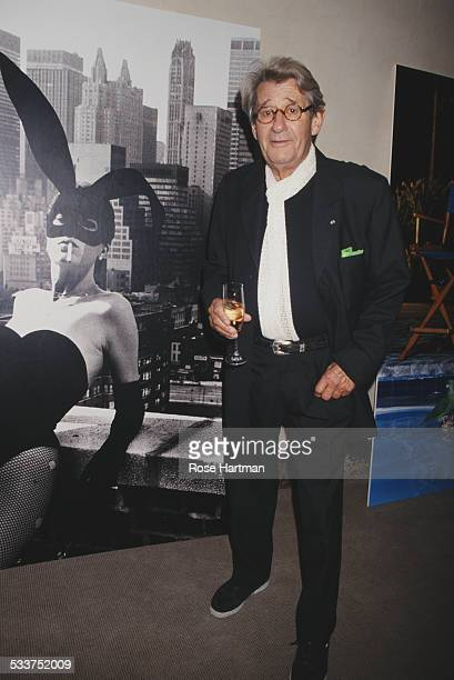 GermanAustralian photographer Helmut Newton at Christie's in front of his photograph of Elsa Peretti New York City USA 1998