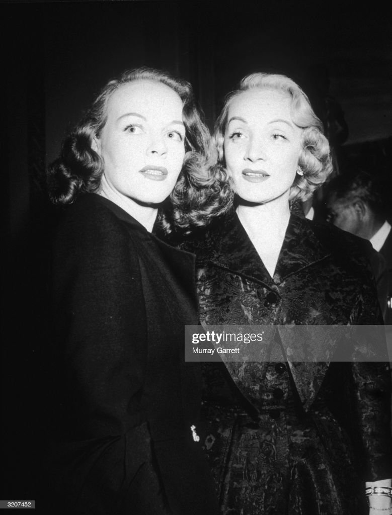 German-born actor <a gi-track='captionPersonalityLinkClicked' href=/galleries/search?phrase=Marlene+Dietrich&family=editorial&specificpeople=70018 ng-click='$event.stopPropagation()'>Marlene Dietrich</a> (1901 - 1992) (R) and her daughter <a gi-track='captionPersonalityLinkClicked' href=/galleries/search?phrase=Maria+Riva&family=editorial&specificpeople=233699 ng-click='$event.stopPropagation()'>Maria Riva</a> pose together, while celebrating Dietrich's 21st year in Hollywood, California. Riva looks over her shoulder, wearing a dark overcoat.