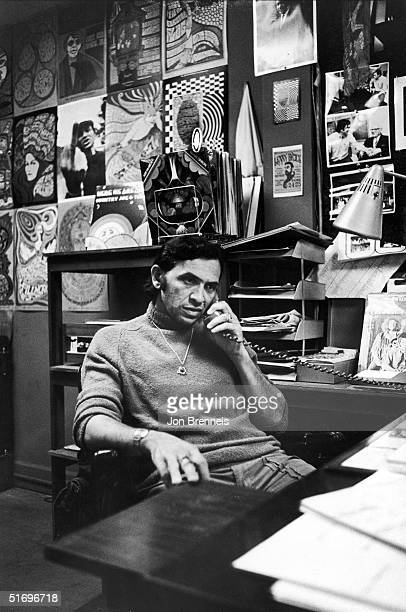 Germanborn American businessman Bill Graham rock concert producer and promoter talks on the phone in his office at the Fillmore West music club San...