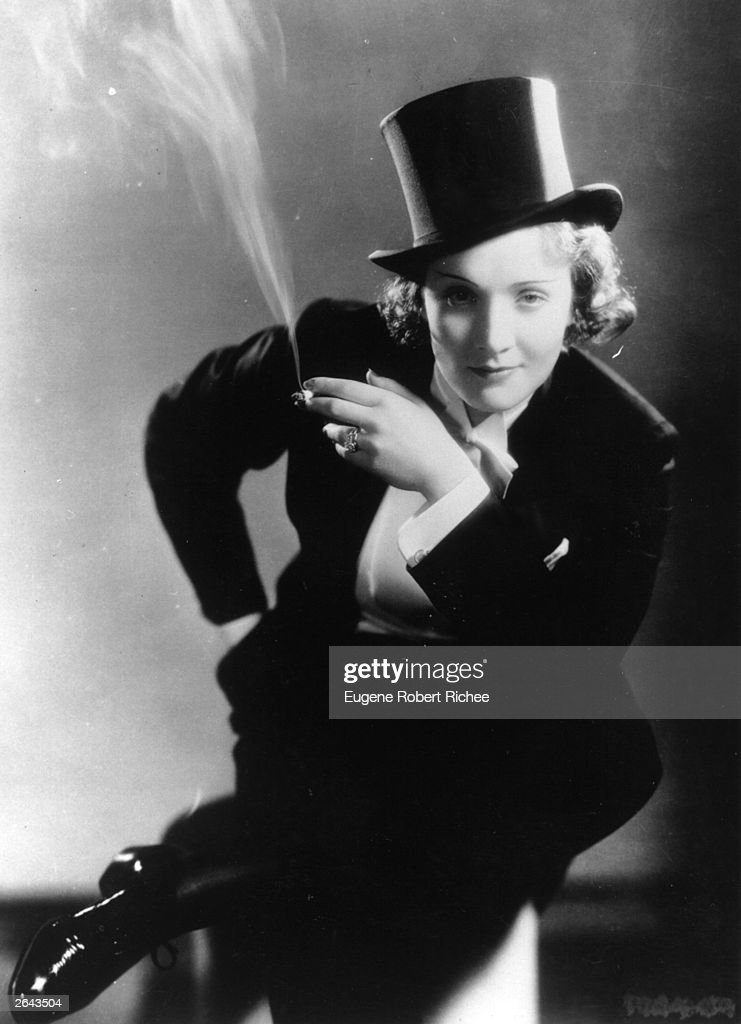 German-born American film star Marlene Dietrich (1901 - 1992) dressed in men's top hat and tails from the film 'Morocco'.