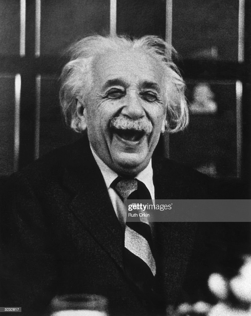 German-born American physicist <a gi-track='captionPersonalityLinkClicked' href=/galleries/search?phrase=Albert+Einstein&family=editorial&specificpeople=70023 ng-click='$event.stopPropagation()'>Albert Einstein</a> (1879 - 1955) laughs at a luncheon, Princeton, New Jersey.