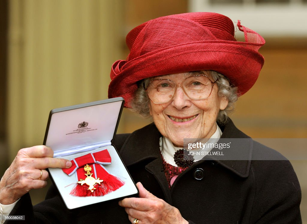 German-born British author Judith Kerr poses for a picture with her Order of the British Empire (OBE) medal after it was presented to her by the Prince of Wales during the Investiture ceremony at Buckingham Palace in central London on January 25, 2013.