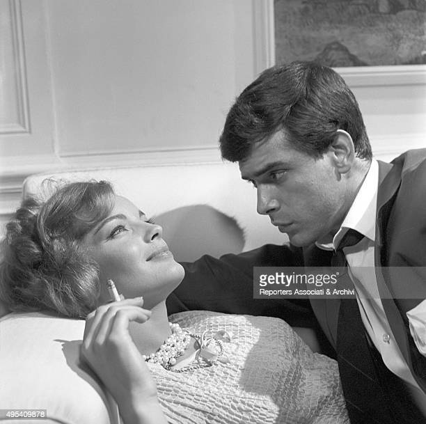 Germanborn French actress Romy Schneider smoking a cigarette beside Cubanborn American actor Tomas Milian in the episode Il lavoro from the film...