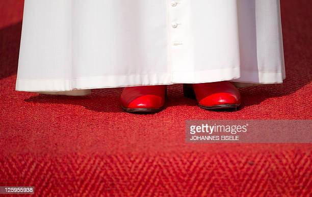 Germanborn Pope Benedict XVI red shoes are seen as he attends his welcoming ceremony at the Bellevue Palace in Berlin on September 22 the first day...