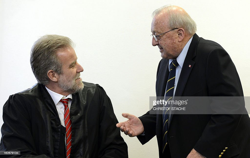 German-Canadian arms dealer Karlheinz Schreiber (R) speaks with his lawyer Frank Eckstein prior to proceedings at the regional court in Augsburg, southern Germany, on February 26, 2013. Schreiber played a central role in a sprawling slush-fund affair that rocked the Christian Democratic Union (CDU) party in the 1990s and tarnished the legacy of former chancellor Helmut Kohl. AFP PHOTO/CHRISTOF STACHE