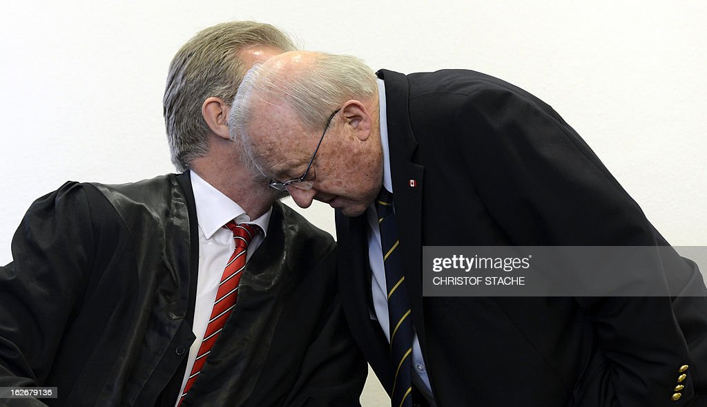 German-Canadian arms dealer Karlheinz Schreiber (R) speaks with his lawyer Frank Eckstein prior to proceedings at the regional court in Augsburg, southern Germany, on February 26, 2013. Schreiber played a central role in a sprawling slush-fund affair that rocked the Christian Democratic Union (CDU) party in the 1990s and tarnished the legacy of former chancellor Helmut Kohl.