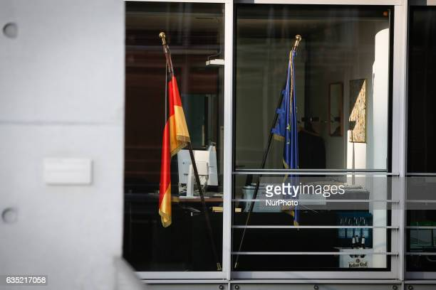 Germand and EU flags are seen inside an office one of the parliamentary buildings on 13 February 2017