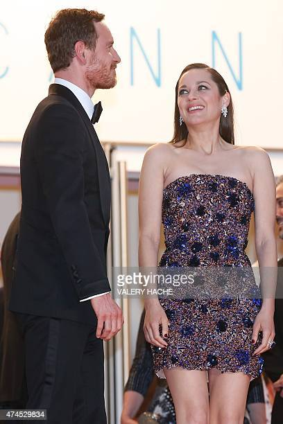 GermanIrish actor Michael Fassbender and French actress Marion Cotillard leave the Festival palace after the screening of the film 'Macbeth' at the...
