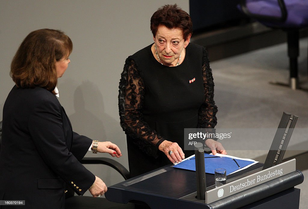 German-Israeli writer Inge Deutschkron leaves the podium after delivering her speech at the German lower house of Parliament Bundestag, in Berlin on January 30, 2013 during a memorial held by deputies for the victims of the Nazi regime, and the anniversary of the liberation of Auschwitz concentration camp on January 27, 1945. Since the date fell on a Sunday this year, the event was held later, on the day marking 80 years since Adolf Hitler became chancellor. BERRY