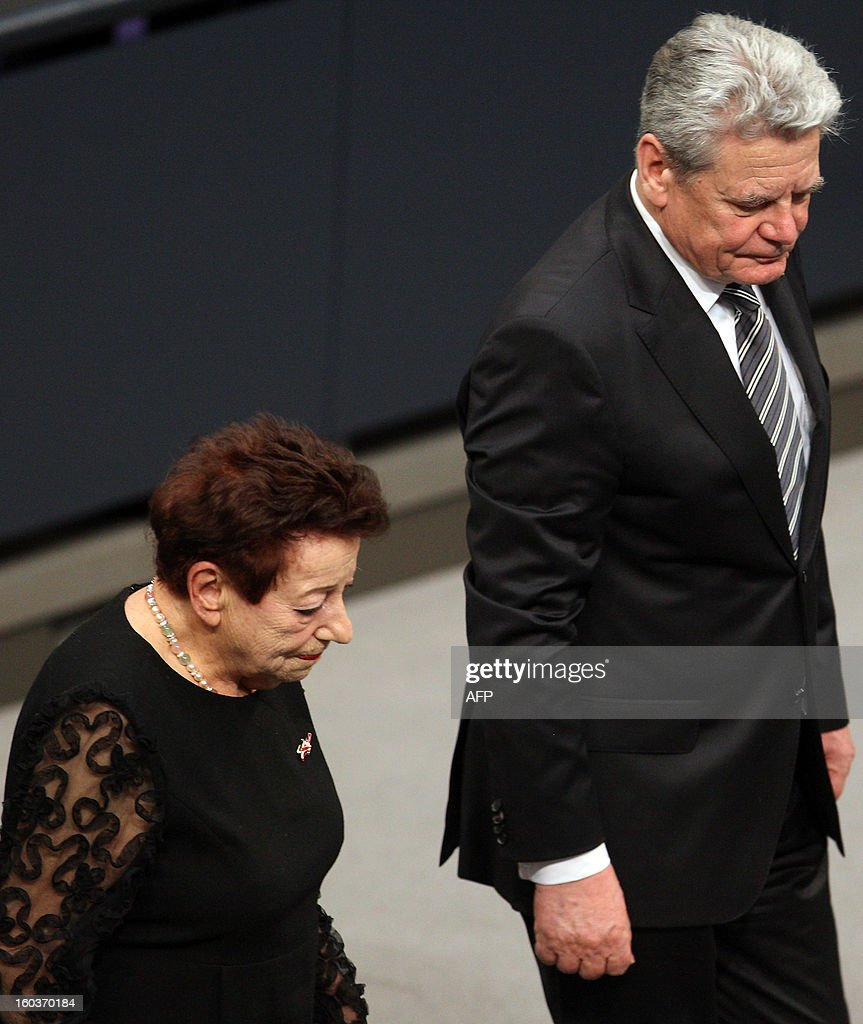 German-Israeli writer Inge Deutschkron (L) leaves the podium next to German President Joachim Gauck after delivering a speech at the German lower house of Parliament Bundestag, in Berlin on January 30, 2013 during a memorial held by deputies for the victims of the Nazi regime, and the anniversary of the liberation of Auschwitz concentration camp on January 27, 1945. Since the date fell on a Sunday this year, the event was held later, on the day marking 80 years since Adolf Hitler became chancellor. BERRY