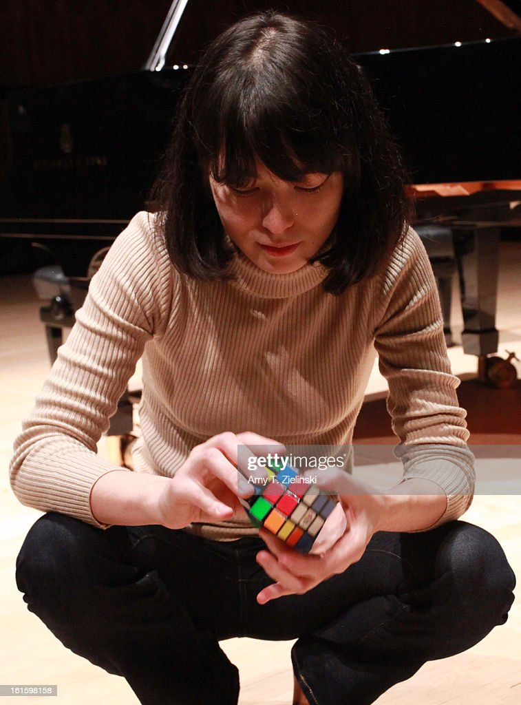 German-Japanese concert pianist Alice Sara Ott demonstrates using her Rubik's Cube to warm up her fingers after rehearsing on stage piano works by composer Robert Schumann, Franz Schubert and Modest Petrovich Mussorgsky's 'Pictures at an Exhibition' before performance as part of the International Piano Series 2012-13 at the Royal Festival Hall on February 12, 2013 in London, England.