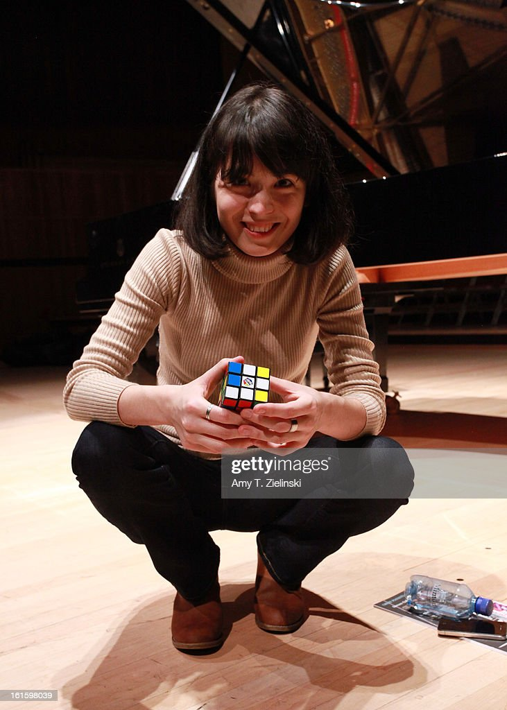 German-Japanese concert pianist Alice Sara Ott looks up as she demonstrates using her Rubik's Cube to warm up her fingers after rehearsing on stage piano works by composer Robert Schumann, Franz Schubert and Modest Petrovich Mussorgsky's 'Pictures at an Exhibition' before performance as part of the International Piano Series 2012-13 at the Royal Festival Hall on February 12, 2013 in London, England.