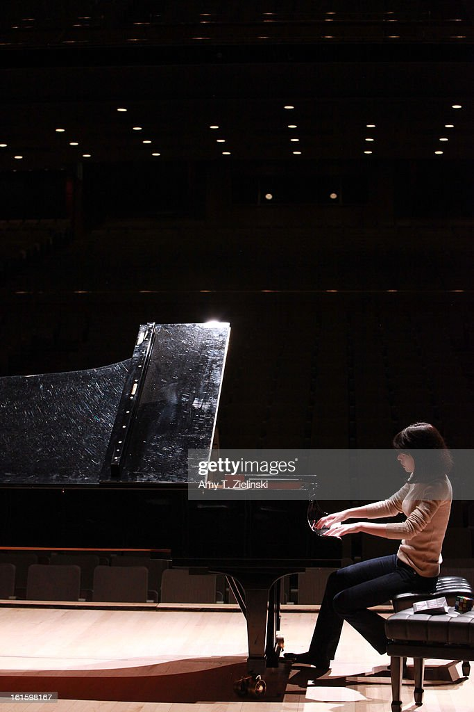 German-Japanese concert pianist Alice Sara Ott rehearses on stage piano works by composer Robert Schumann, Franz Schubert and Modest Petrovich Mussorgsky's 'Pictures at an Exhibition' before a performance as part of the International Piano Series 2012-13 at the Royal Festival Hall on February 12, 2013 in London, England.