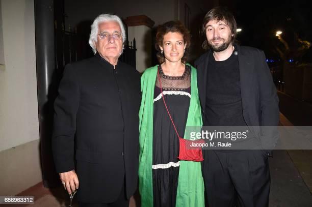Germano Celant Ginevra Elkann and Francesco Vezzoli attend Fondazione Prada Private Dinner during the 70th annual Cannes Film Festival at Restaurant...