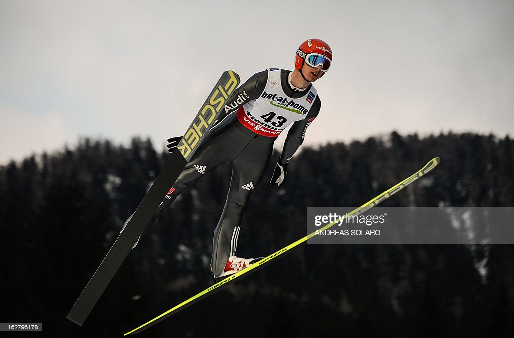 German's Andreas Wank soars through the air on February 27, 2013 during the Large Hill Individual qualification race of the FIS Nordic World Ski Championships at the Ski Jumping stadium in Predazzo, northern Italy. AFP PHOTO / ANDREAS SOLARO