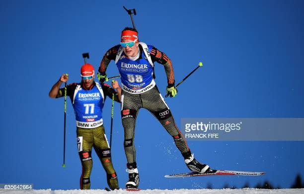 German's Arnd Peiffer and compatriot Benedikt Doll compete during the Men 20 km Individual event at the FIS Biathlon World Championships in...