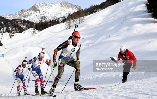 German's Benedikt Doll and Norway's Ole Einar Bjorndalen compete during the Men's 125 km pursuit race during the 2017 IBU Biathlon World...