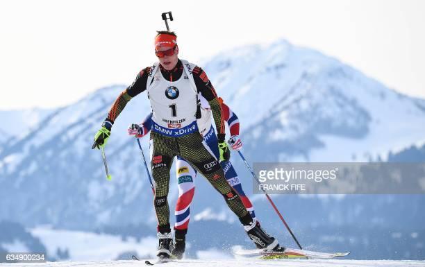 German's Benedikt Doll competes during the 2017 IBU World Championships Biathlon Men's 125 km Pursuit race in Hochfilzen on February 12 2017 / AFP /...