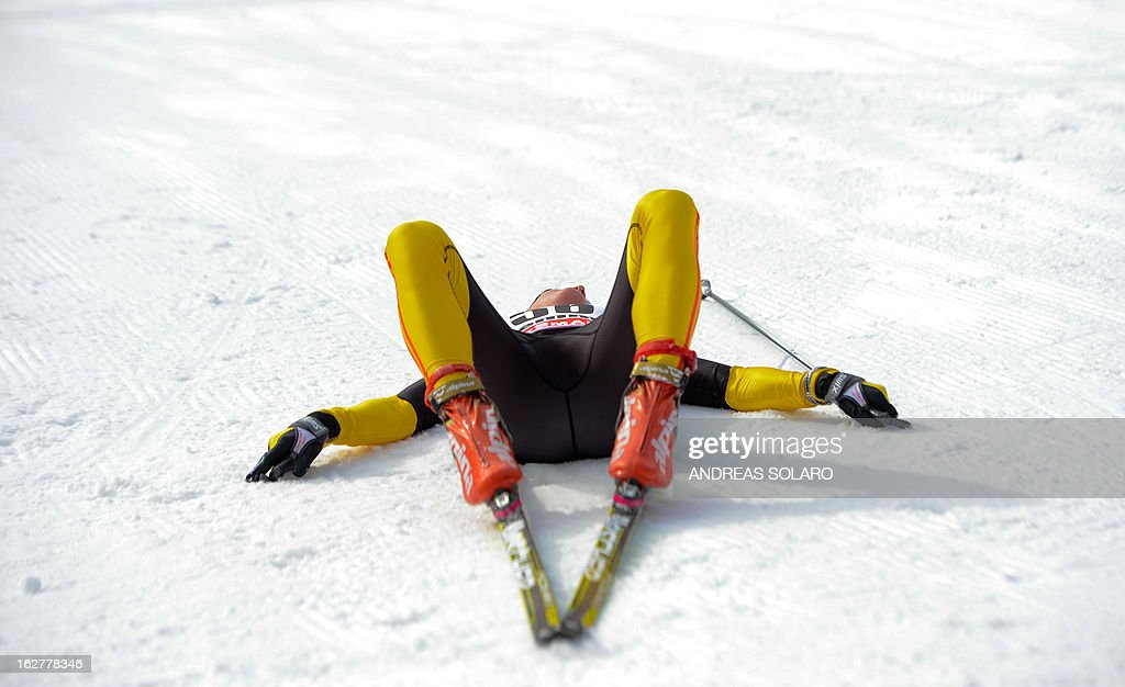 German's Denise Herrmann lies down inside the finish area on February 26, 2013, at the end of the Women's Cross Country skiing 10 Km Free Individual of the FIS Nordic World Ski Championships at Val Di Fiemme Cross Country stadium in Cavalese, north Italy .