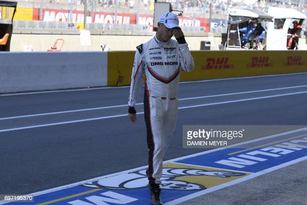 German's driver Andre Lotterer reacts after he abandoned due to a mechanical problem on his Porsche 919 Hybrid N°1 during the Le Mans 24 hours...