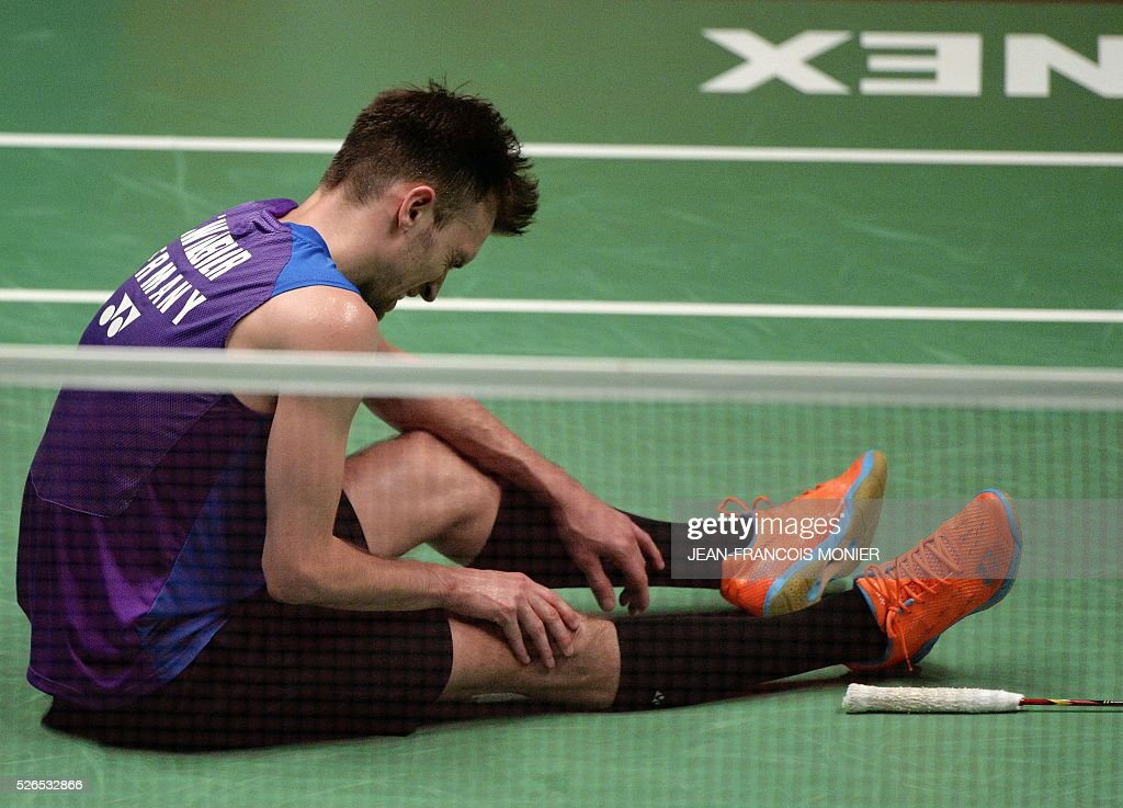 German's Marc Zwiebler suffers from cramps during the Men's simple semi-final match between Germany and Denmark during the 2016 European Badminton Championships, on April 30, 2016 in Mouilleron-le-Captif, western France. / AFP / JEAN
