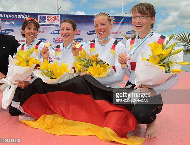 German's MarieLouise Draeger Anja Noske Daniela Reimer and Lena Mueller celebrate after winning the women's lightweight quadruple sculls final during...