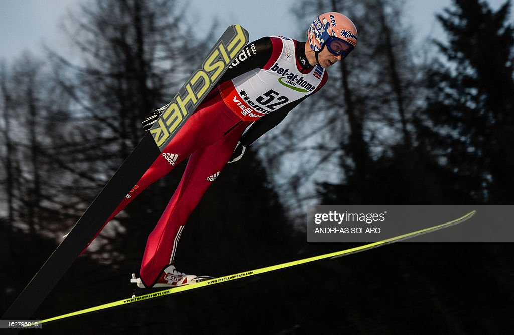 German's Michael Neumayer soars through the air on February 27, 2013 during the Large Hill Individual of the FIS Nordic World Ski Championships at the Ski Jumping stadium in Predazzo, northern Italy.
