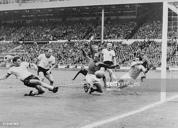 Germans score twiceWolfgang Weber of West Germany scores his team's second goal as England's Ray Wilson and goalie Gordon Banks try to stop ball in...