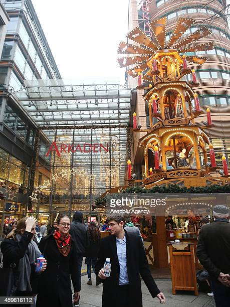 Germans start their Christmas preparation and shopping at the traditional Christmas market in Berlin Germany on November 26 2014 Colorful and...
