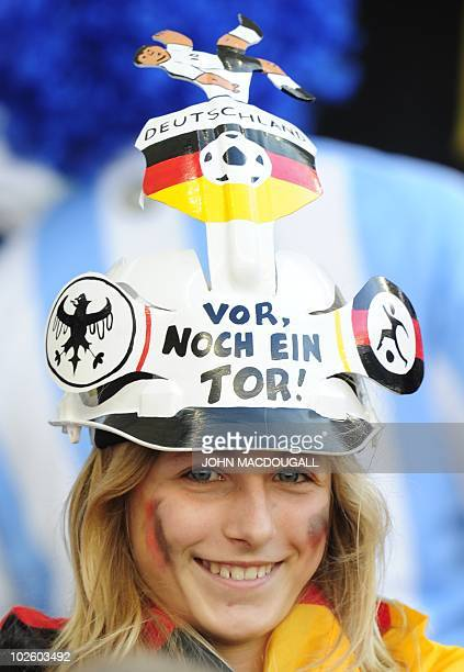 A German's supporter wears a Makarapa reading ' Germany go ahead score another goal' as she stands in the tribune prior the 2010 World Cup...