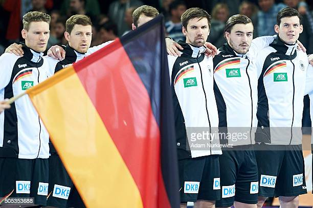 German's team listening national anthem before the Men's EHF Handball European Championship 2016 match between Spain and Germany at Centenial Hall on...