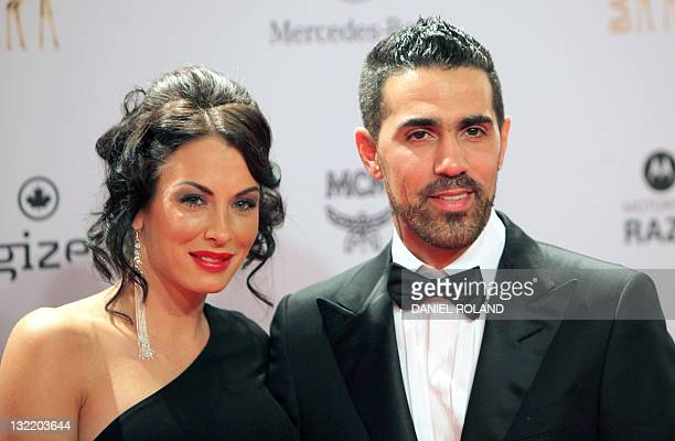 GermanTunisian rap singer Bushido poses with Anna Maria Lagerblom as they arrive for the Bambi awards ceremony in Wiesbaden Germany on November 10...