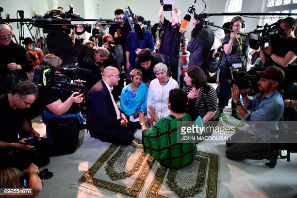 GermanTurkish lawyer author and activist Seyran Ates is surrounded by media as she plans an inaugural friday payer at the Ibn RushdGoethemosque in...